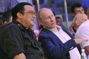 Russian President Vladimir Putin (R) speaks with US actor Steven Seagal (L) during the Mixed fight Championship in the Russian Black Sea resort of Sochi on August 11, 2012.  AFP PHOTO / RIA-NOVOSTI / ALEKSEY NIKOLSKYI        (Photo credit should read ALEKSEY NIKOLSKYI/AFP/GettyImages)